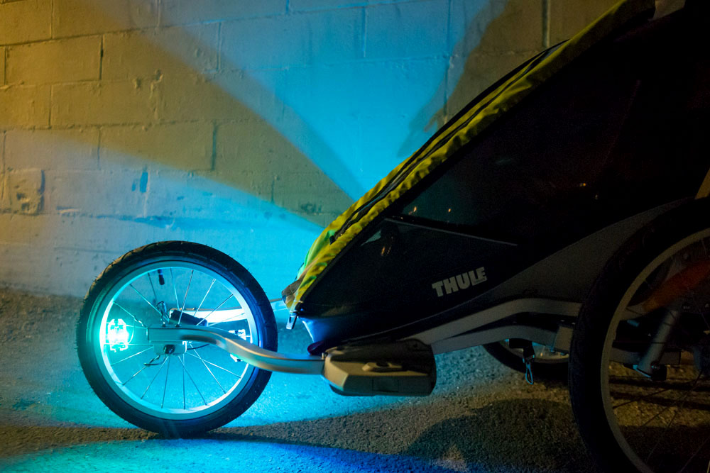 M204 bicycle wheel light on a Thule Chariot jogging stroller