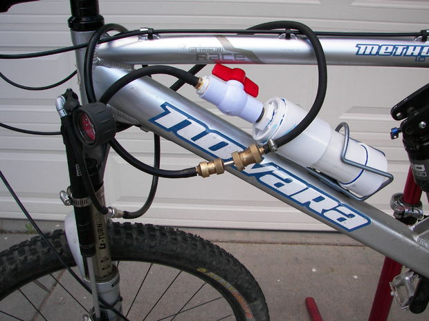 A front shock-powered pump