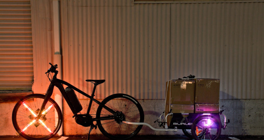 A very well-lit Karmic e-bike and Burley trailer